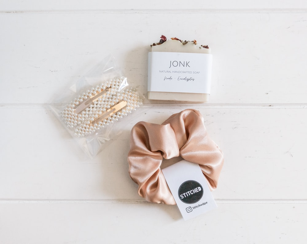 white and gold box on white table