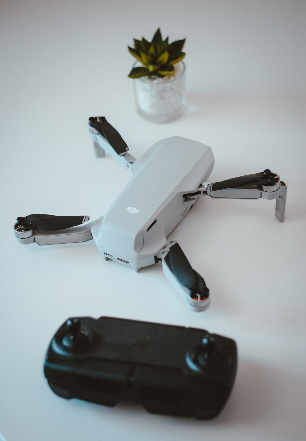 white and black quadcopter drone
