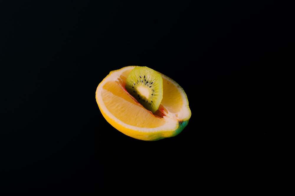 yellow sliced fruit with black background