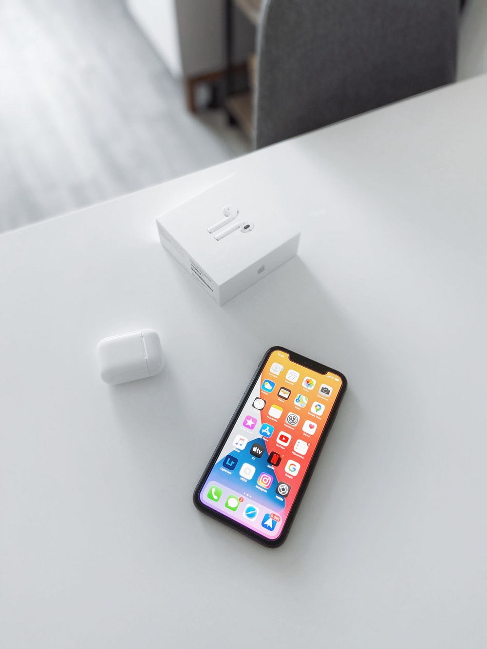 white apple charger beside white apple charger