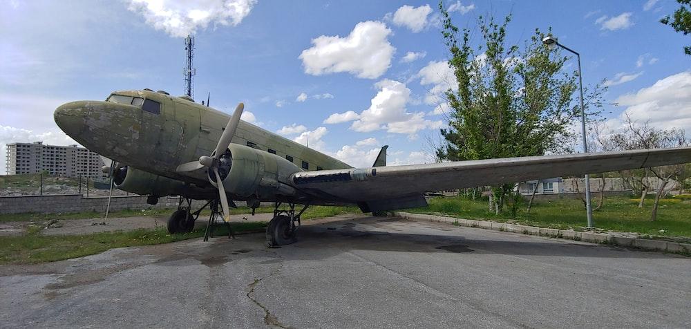 gray fighter plane on gray asphalt road during daytime