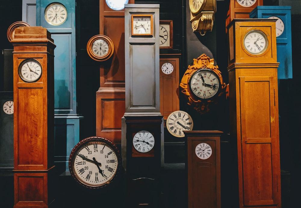 brown wooden framed analog clock