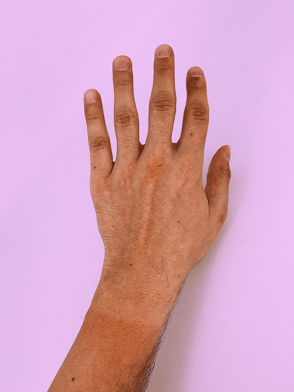 persons left hand on white surface