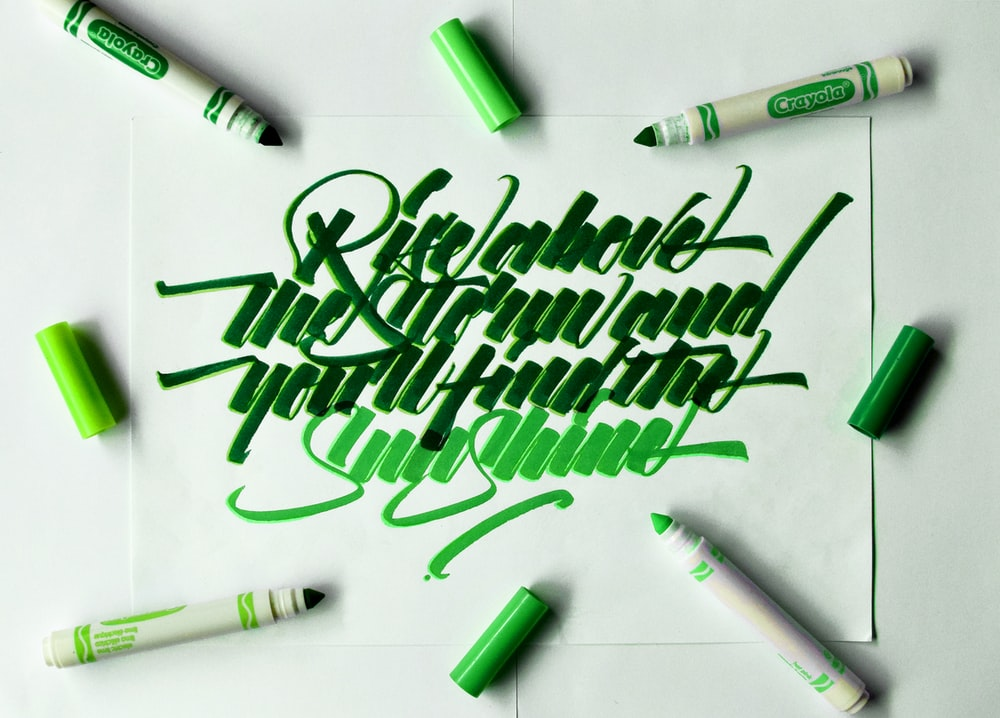 green and white pen on white printer paper