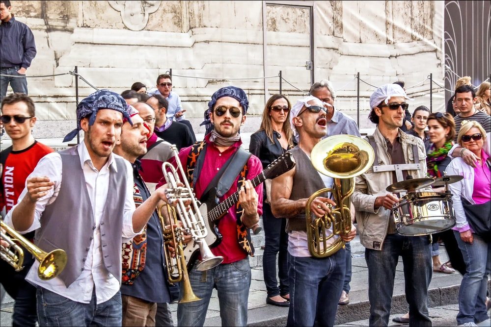 group of people holding musical instruments