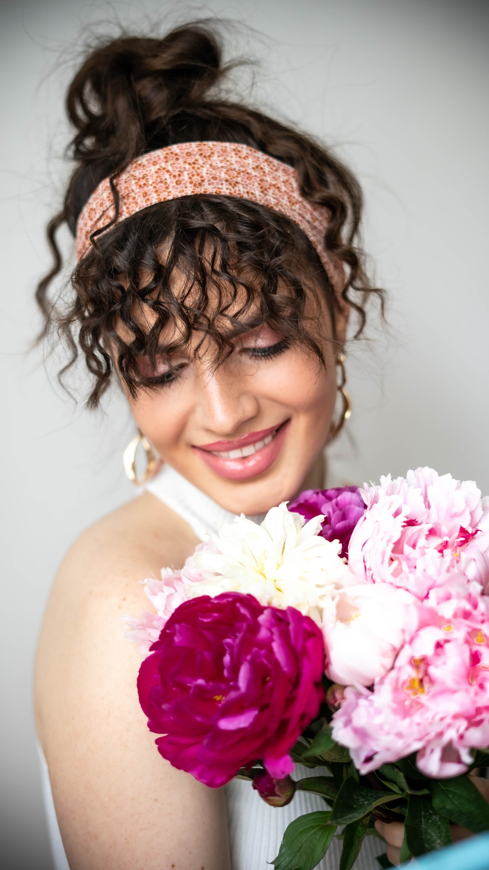 woman in pink floral headdress