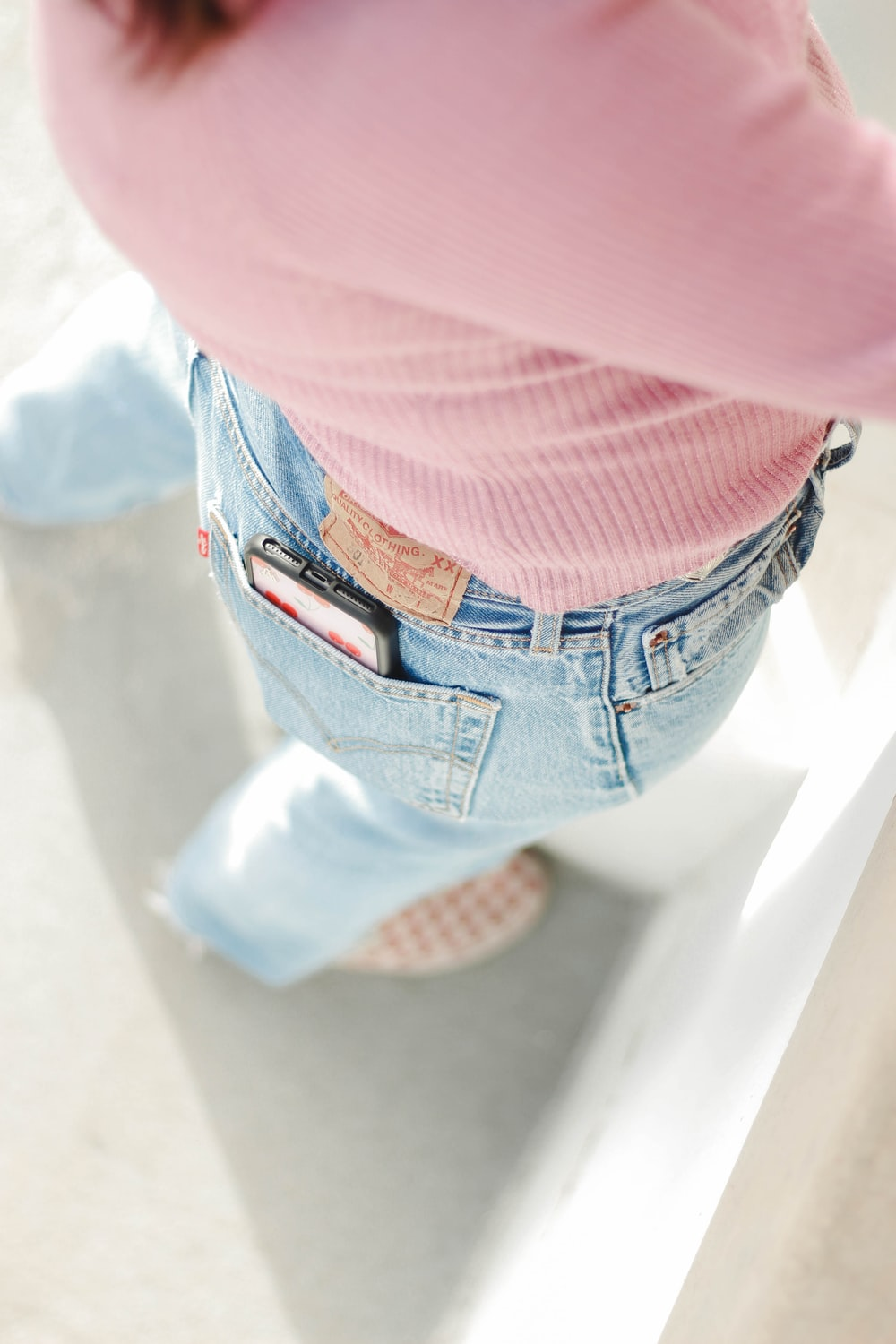 person in blue denim jeans and pink shirt