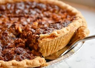 brown pie on white ceramic plate