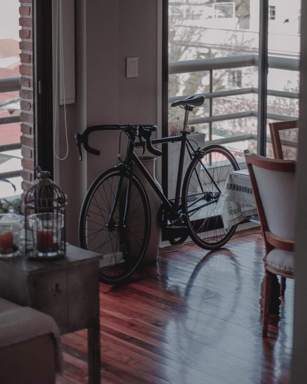 black city bike near glass window