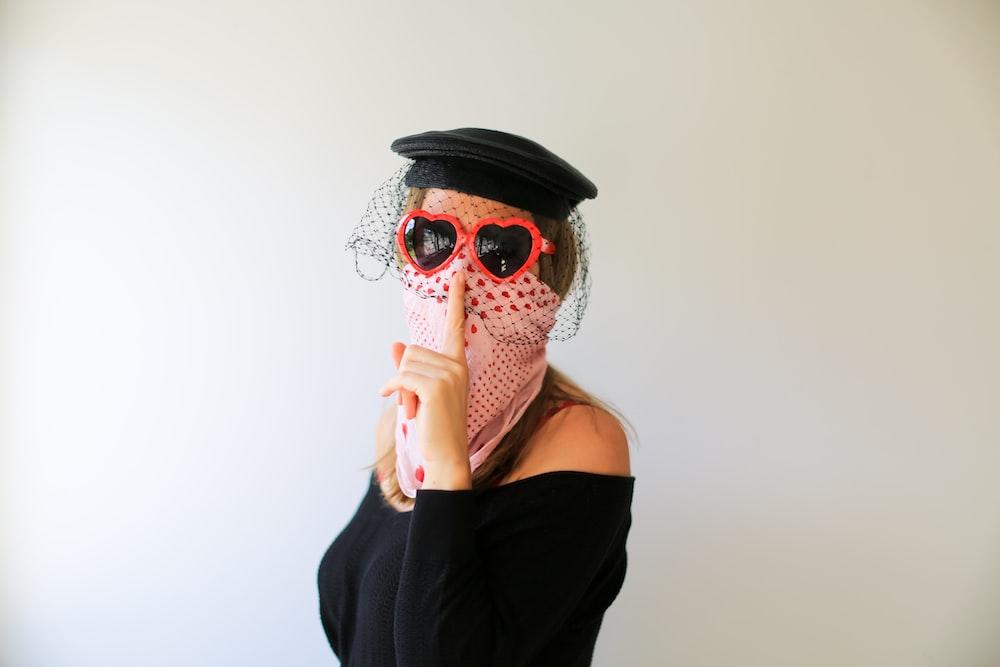 woman in black tank top wearing white mask