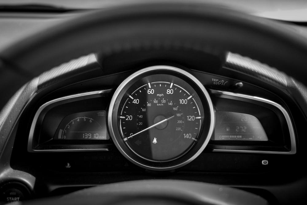 black and white car speedometer