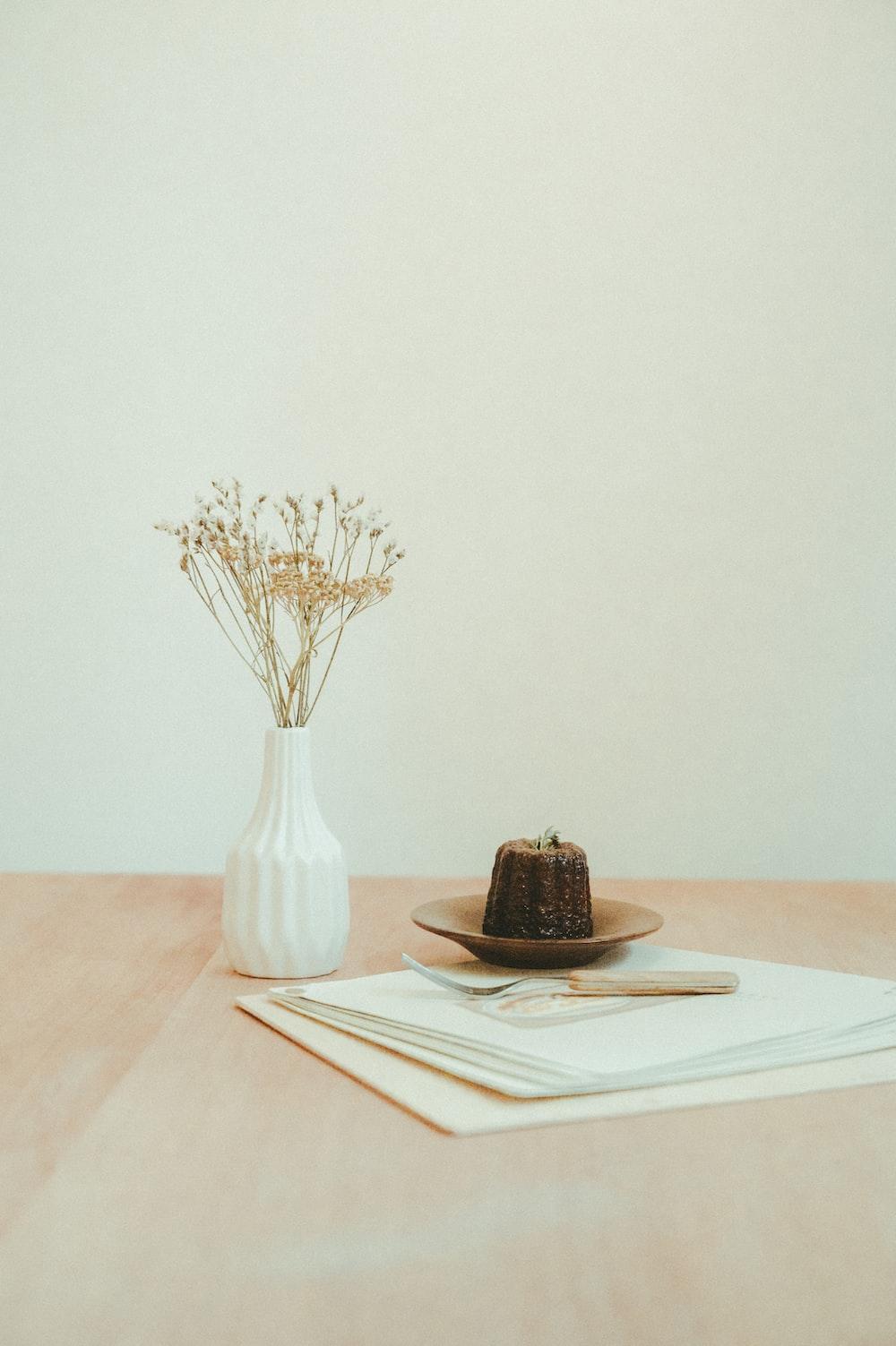 brown and black chocolate cake on white ceramic plate