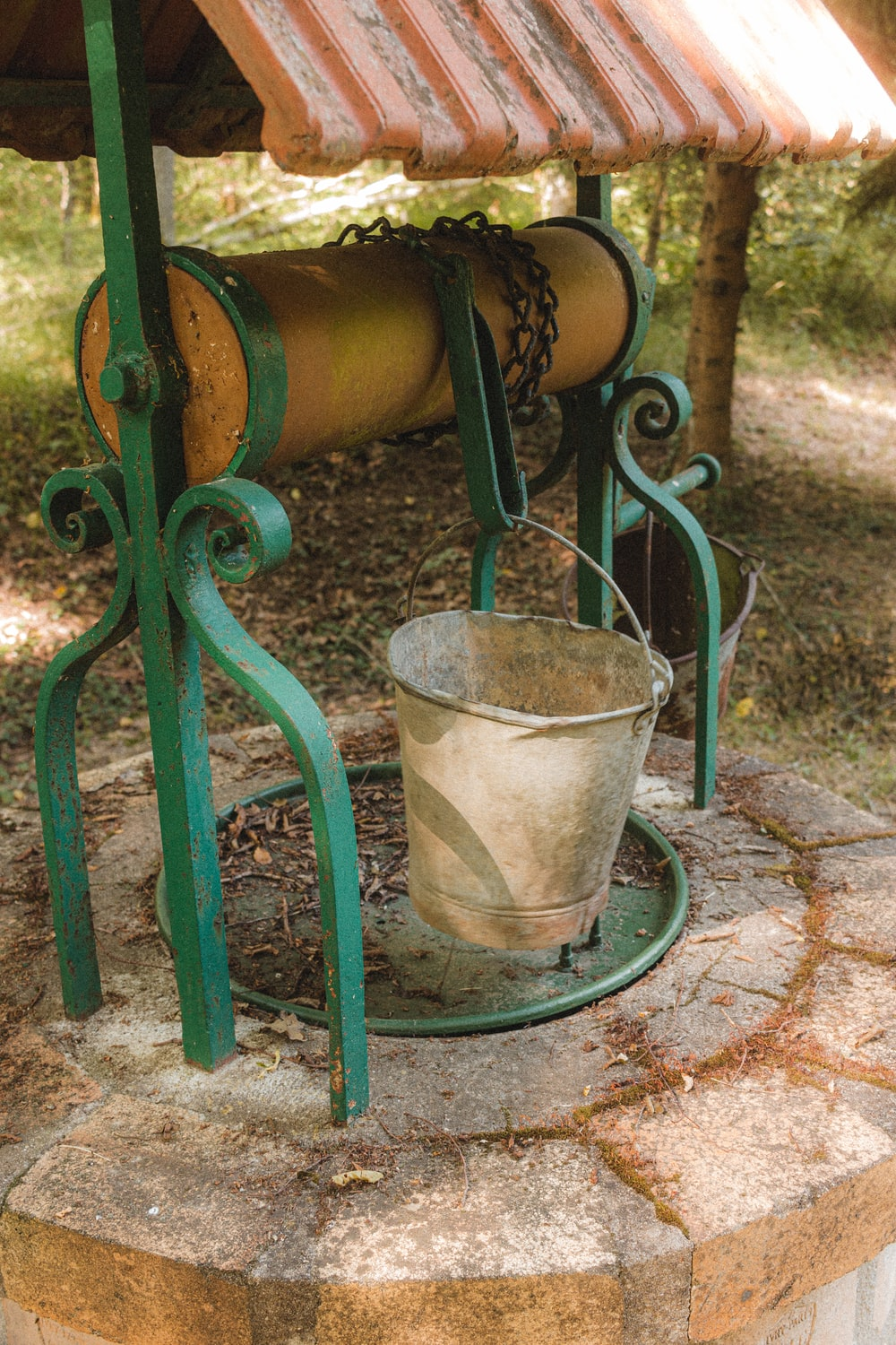 green metal bucket with water