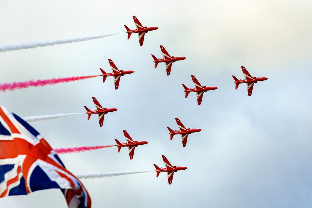 red and white jet plane in the sky