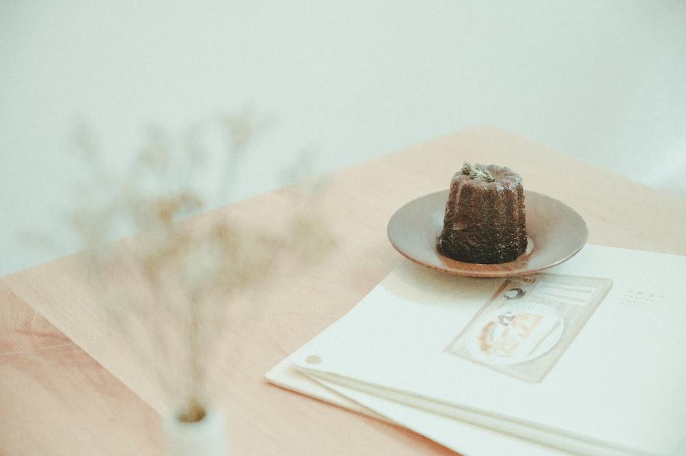 brown chocolate cake on white ceramic plate