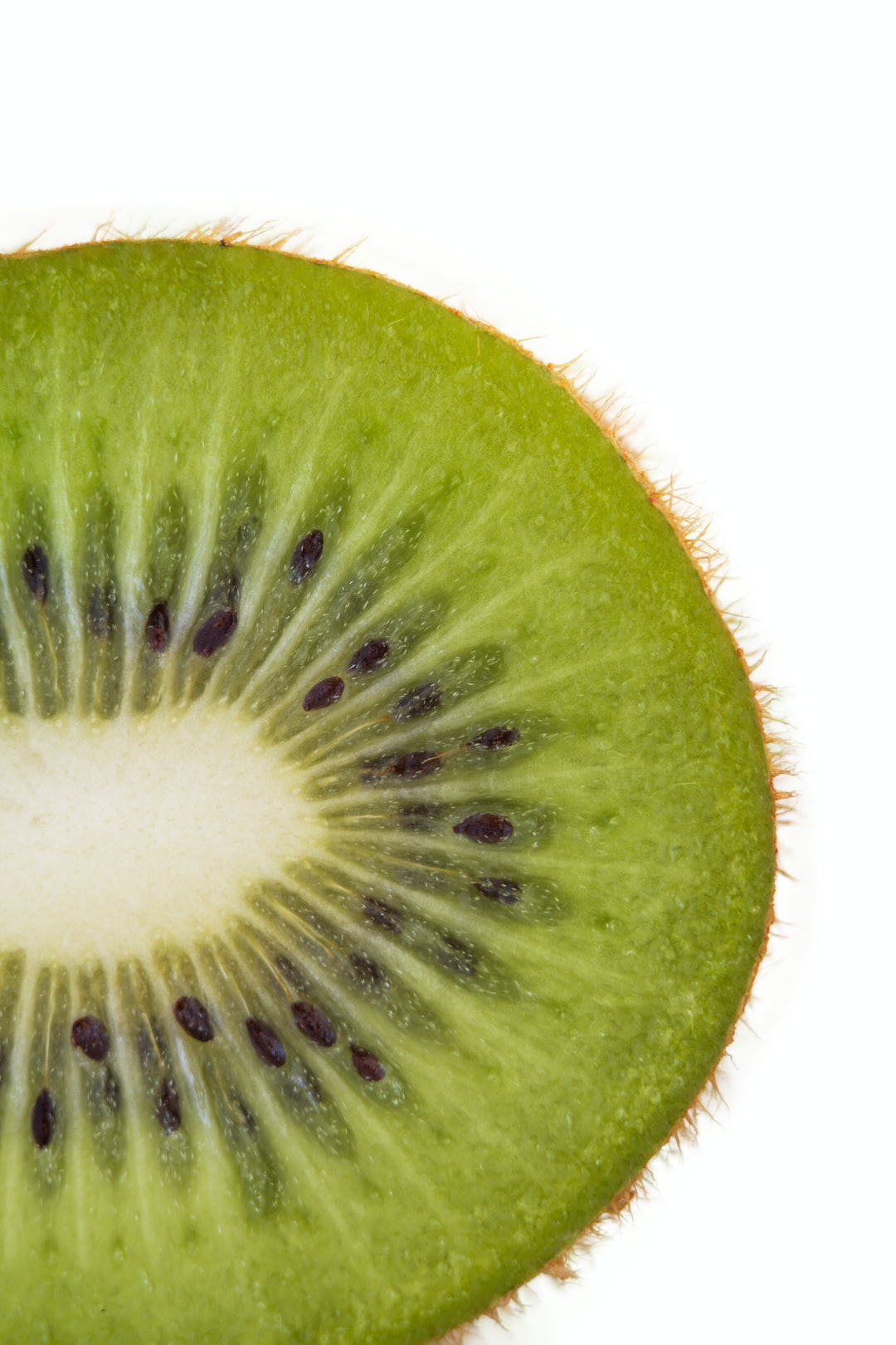 Close up on a slice of kiwi fruit 🥝 - Thanks for visiting! Donations help & motivate me to keep uploading more 📸's. Even a buck or two helps. ➡️ https://www.buymeacoffee.com/uniqueton Found my photos useful? feel free to contact me about anything at email: uniquetonshots@gmail.com IG: @uniquetonshots