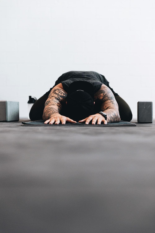 man lying on black bed