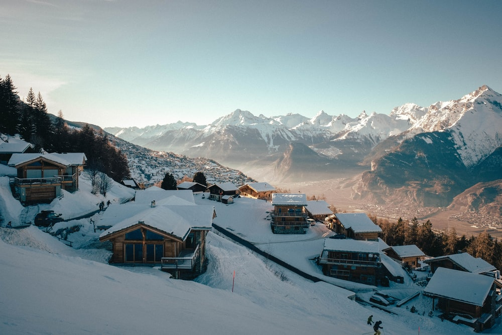 houses on snow covered ground during daytime