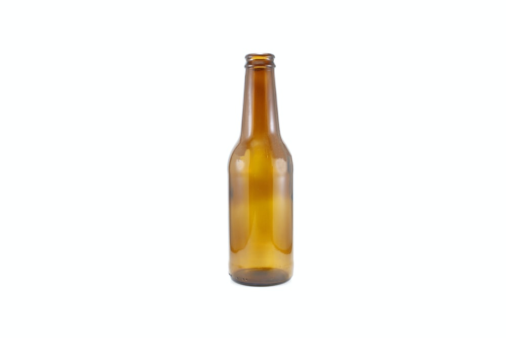 brown glass bottle with yellow liquid