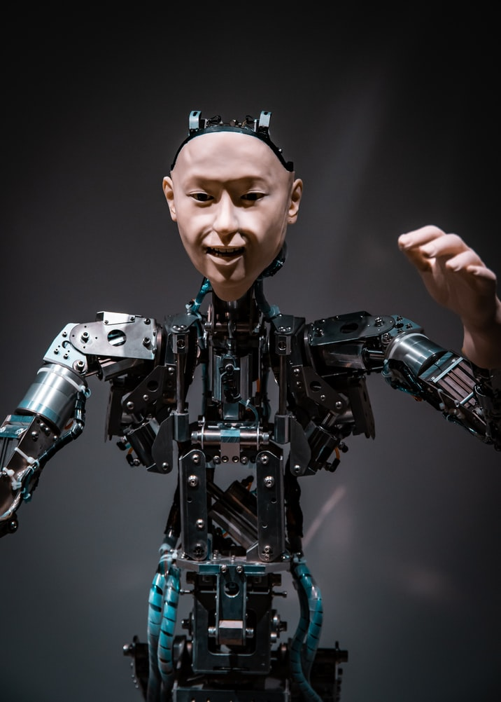 Humanoid robot with human face and mechanical body