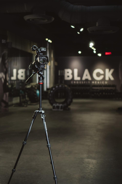 black and gray camera tripod