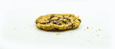 brown cookie on white surface cookie teams background