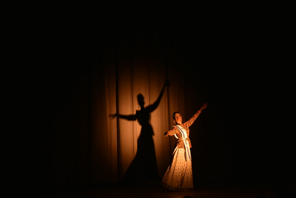 woman in white dress dancing on stage