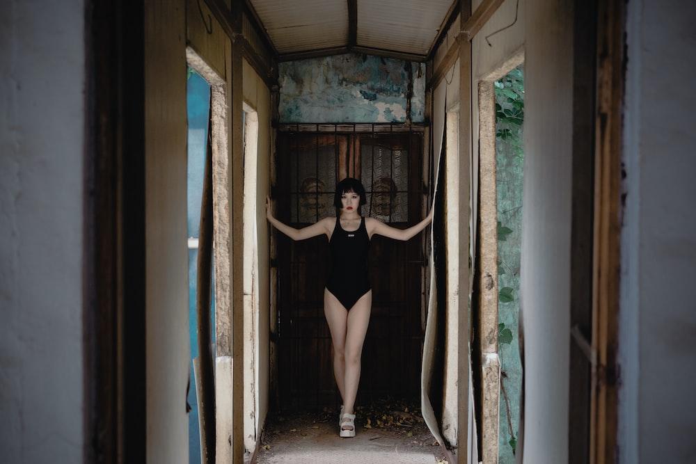 woman in black dress standing on doorway