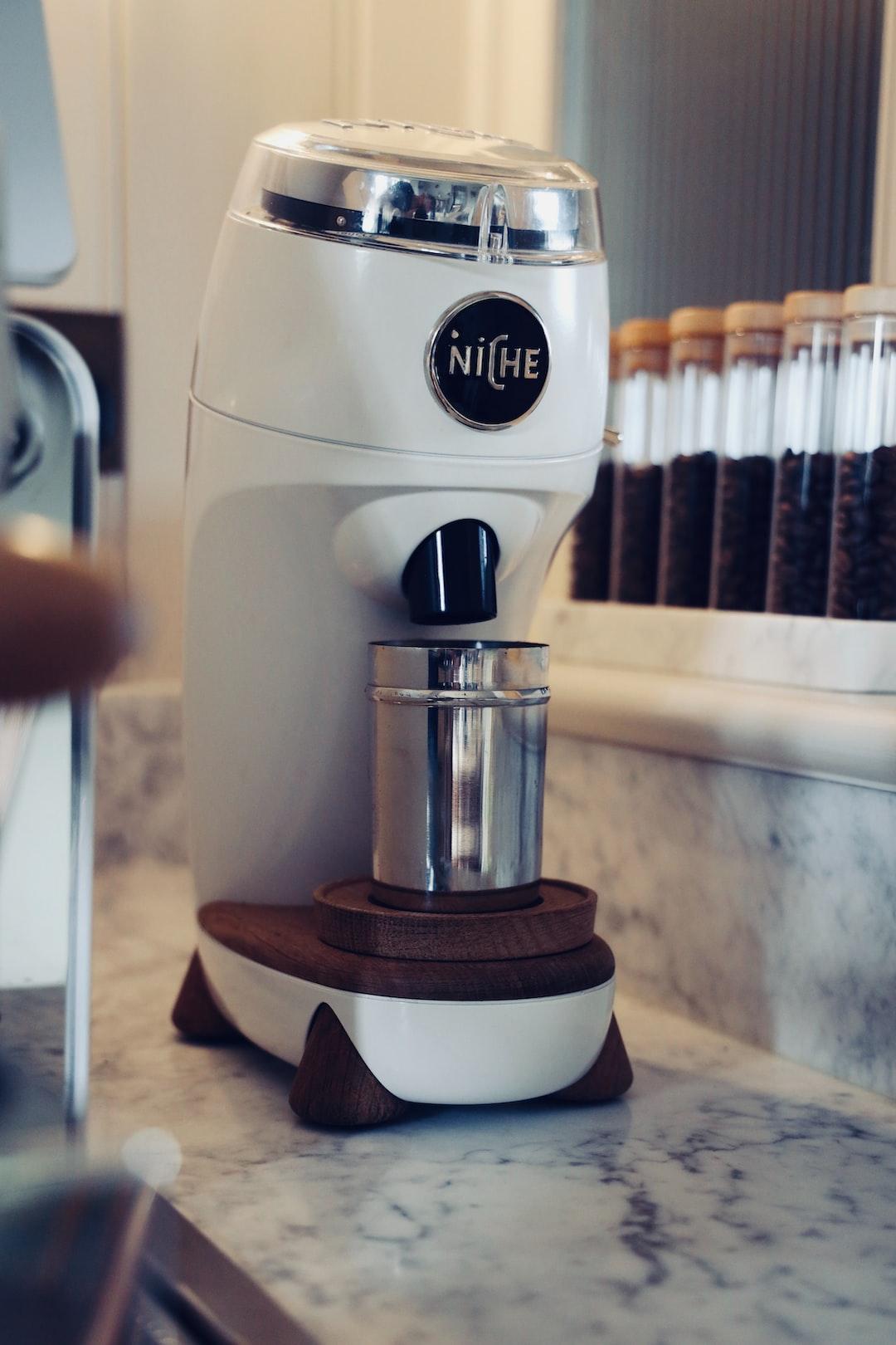 Niche Coffee Bean Grinder sitting on a marble worktop.