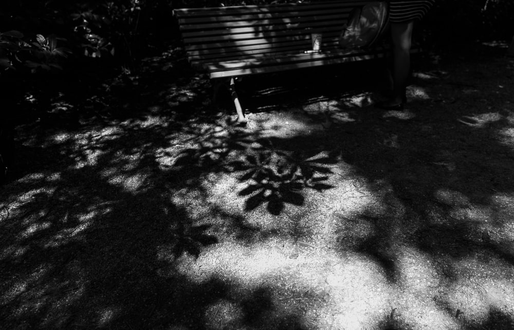 grayscale photo of a wooden bench