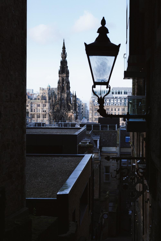 black street light near high rise buildings during daytime