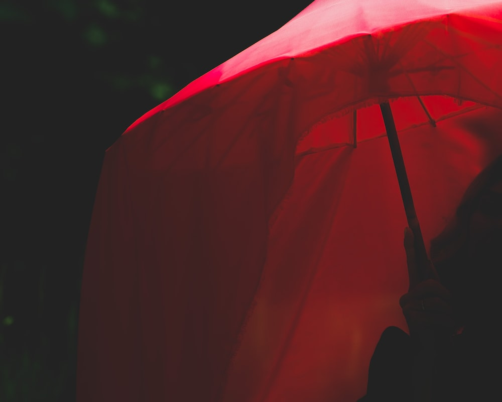 red umbrella in close up photography