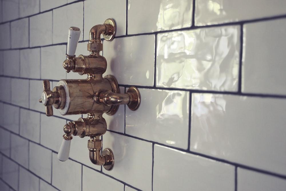 brass door knob on white ceramic tile