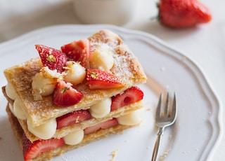 strawberry and banana on white ceramic plate