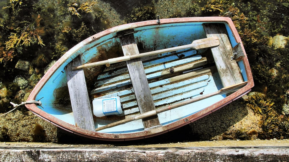 brown wooden boat on brown soil