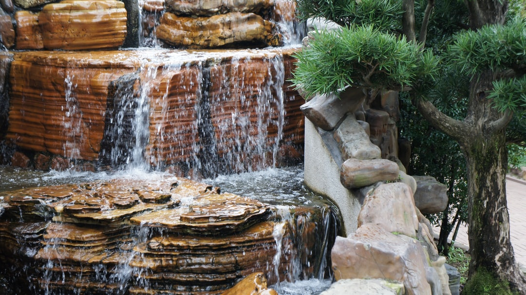 Water flowing over weathered rocks at the Naam Lin Garden.