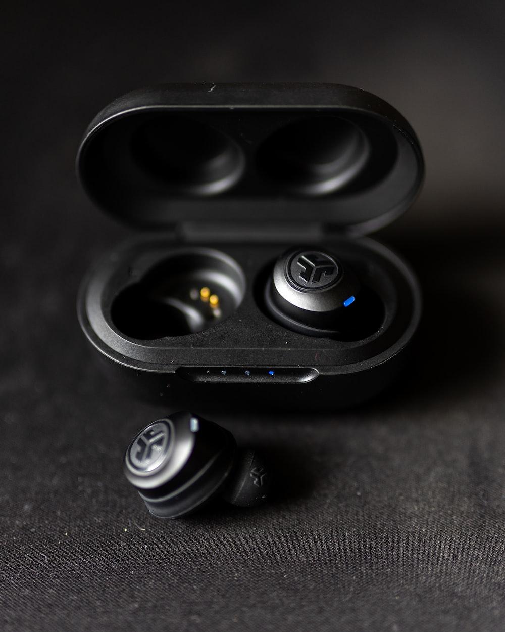 black camera lens on brown textile