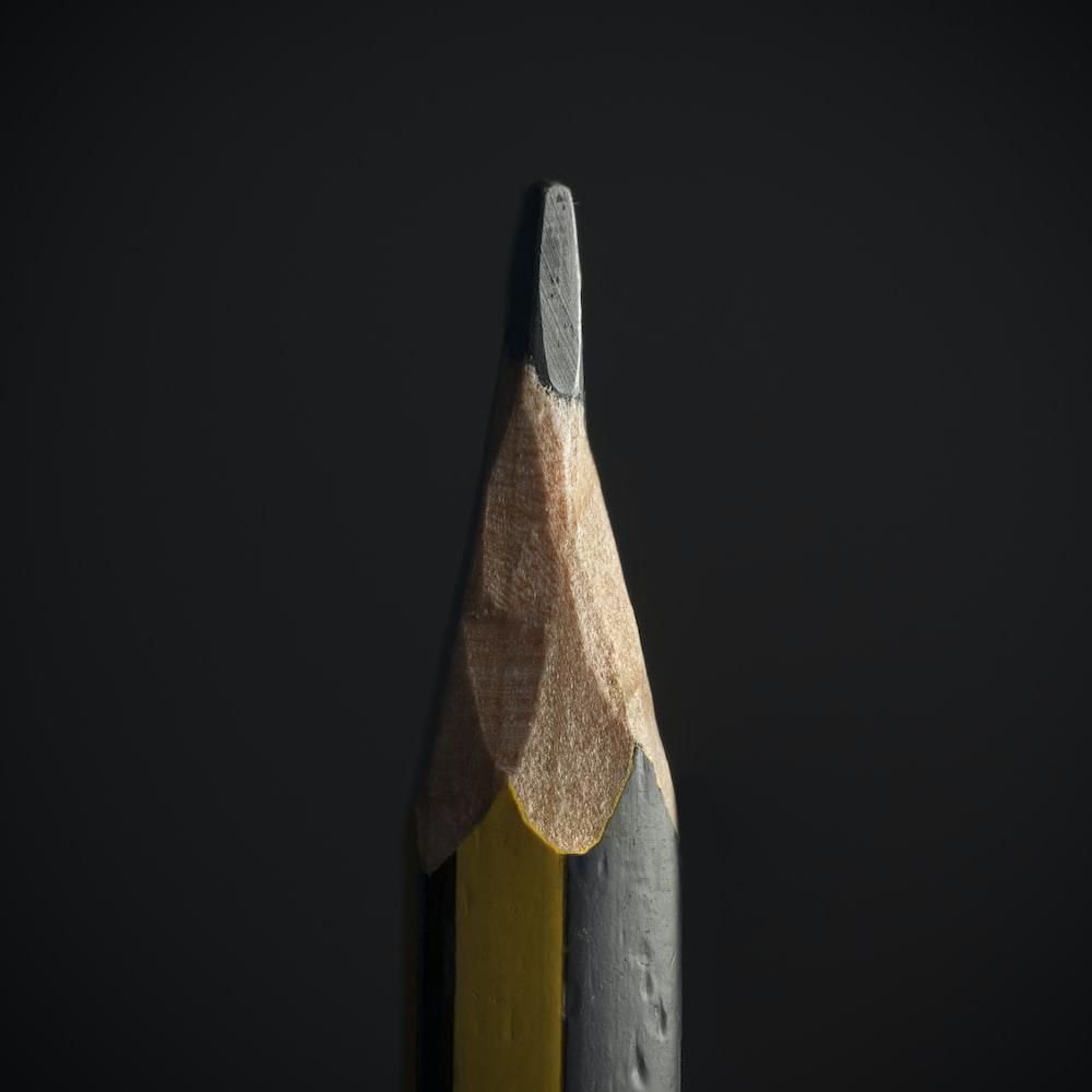 black pencil on black background