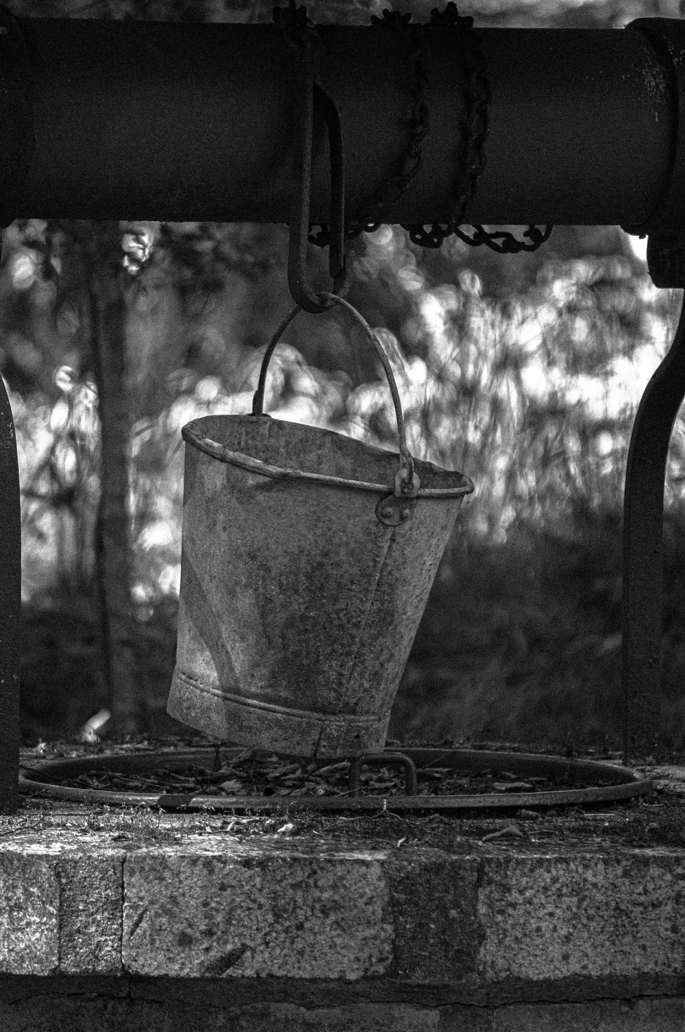 gray scale photo of bucket
