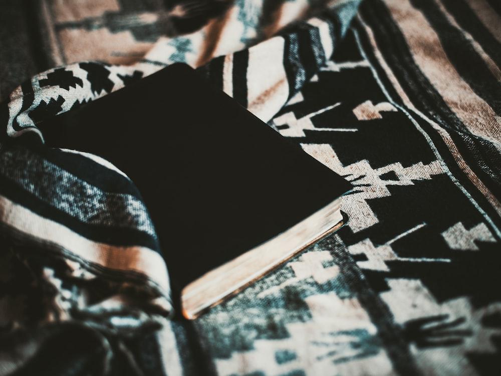 black and white textile on black and white textile
