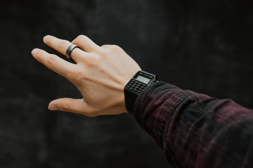 person wearing silver apple watch with black sport band