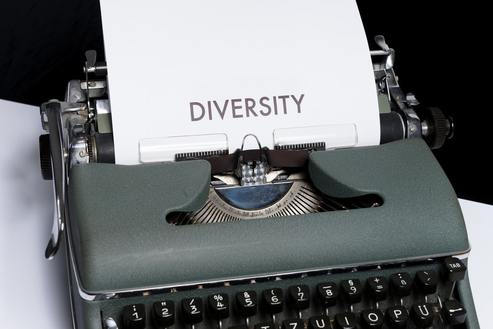 green and white typewriter on white table