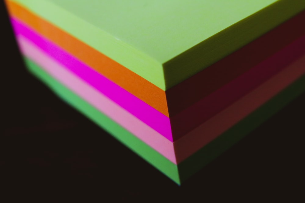 green yellow and pink colored paper