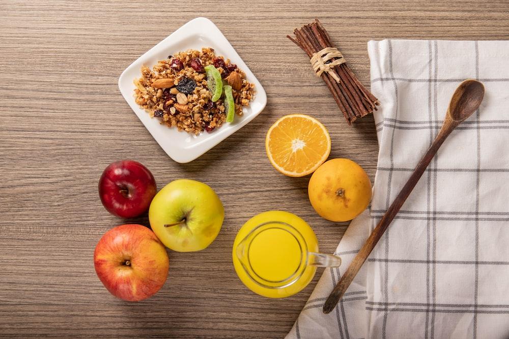 sliced lemon beside white ceramic bowl with food