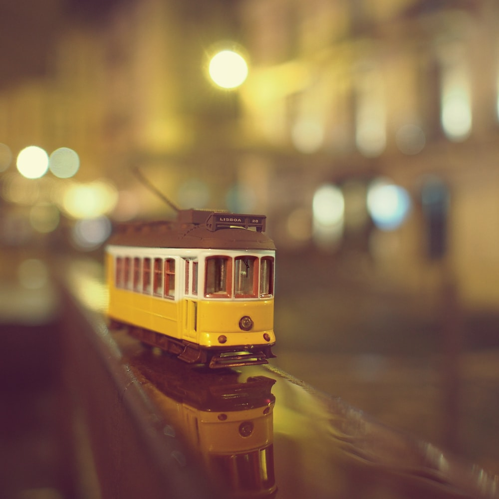 yellow train on the street during night time