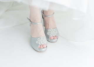 woman in white and brown floral peep toe sandals