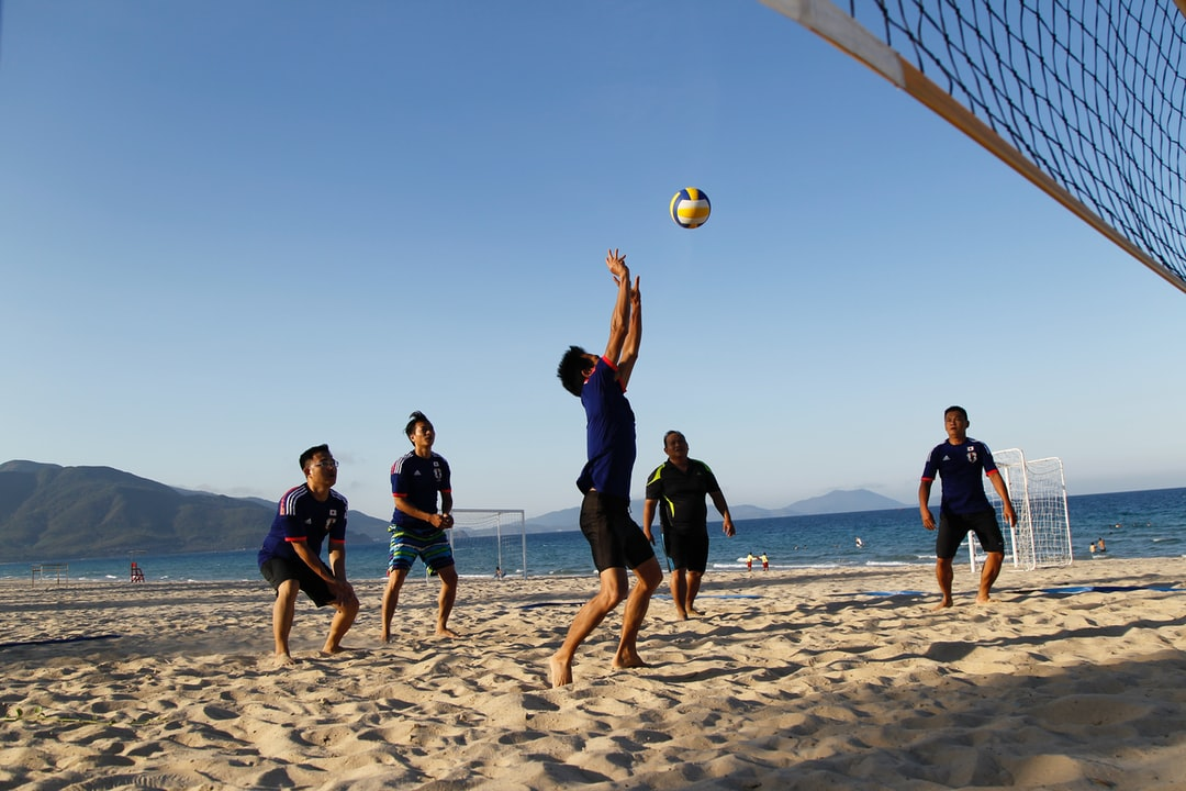 Happy time. Play volley ball with friends.