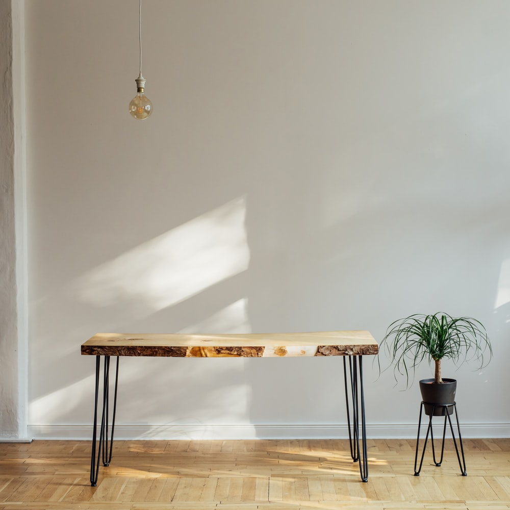 brown wooden table with white table cloth