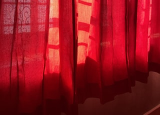 red and brown window curtain