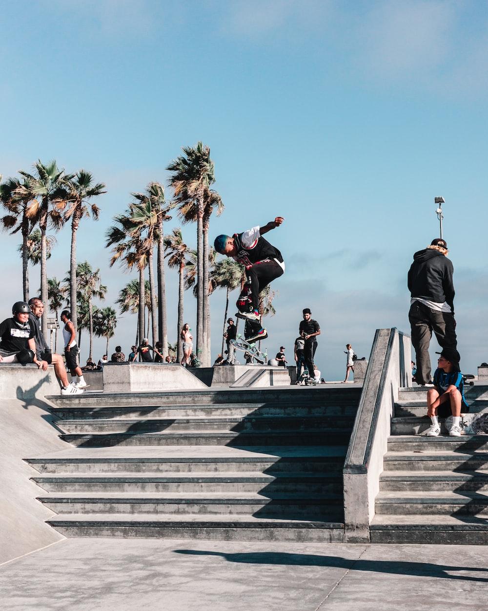 people walking on concrete stairs during daytime